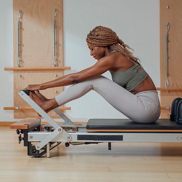 kideaz pilates femme machine exercices